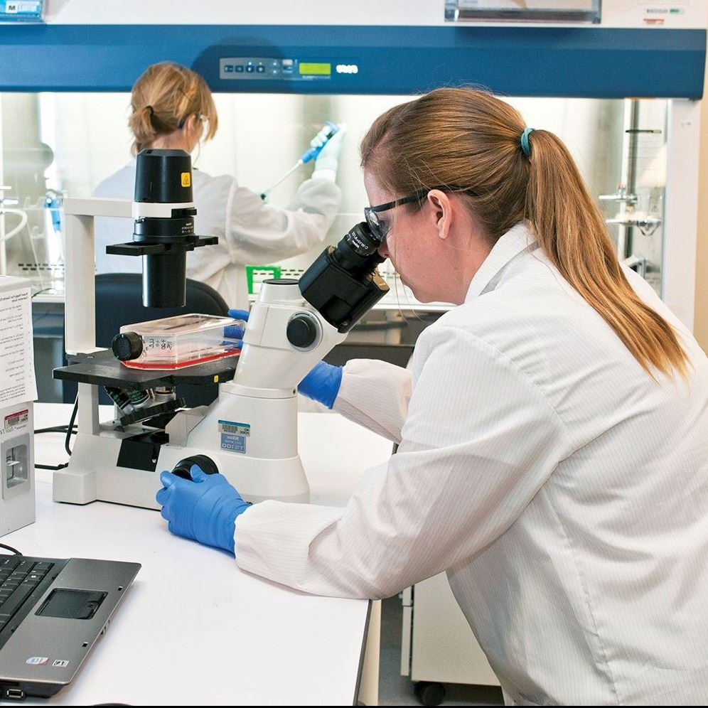 Women in white coats working in a laboratory