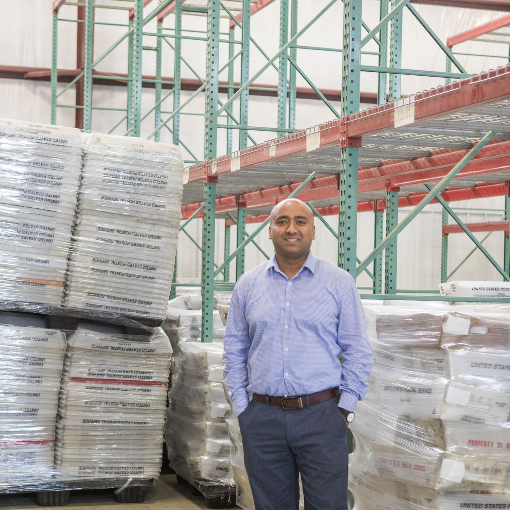 Business man standing in warehouse